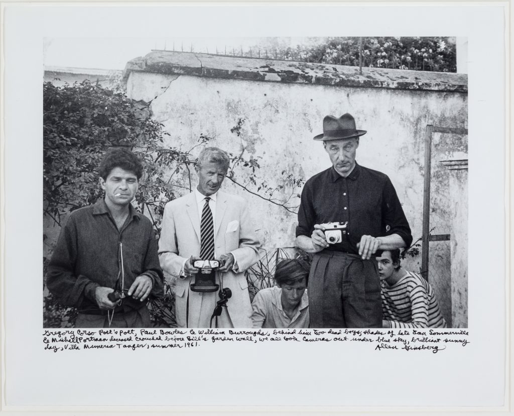 Gregory Corso, Paul Bowles, William Burroughs, Tangier (Michael Portman and Ian Sommerville crouching behind Burroughs), 1961