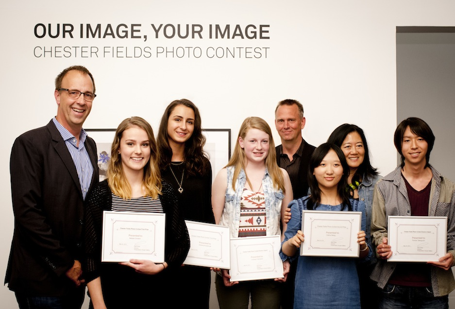 North Vancouver City Councillor Craig Keating (left), with Director/Curator Reid Shier (fourth from right), Minister Naomi Yamamoto (second from right) and the winners of this year's Chester Fields Photo Contest. Photo: Rachel Topham. Courtesy Rachel Topham Photography