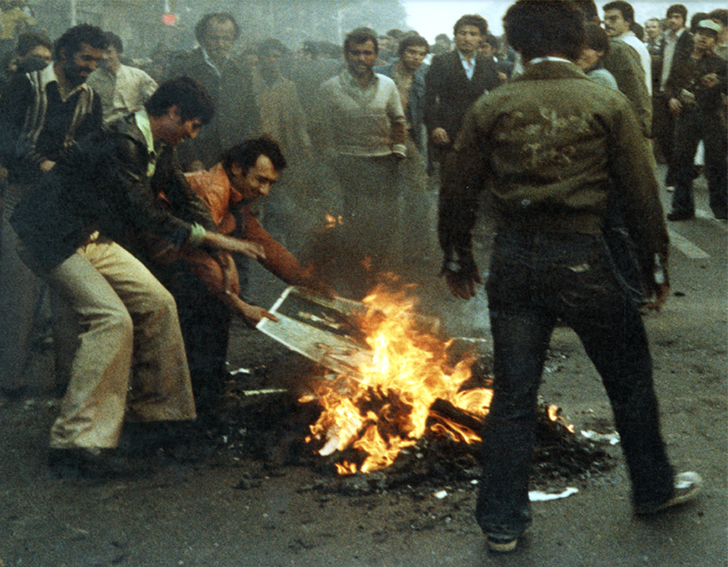 Shah's photographs being burnt for the first time. Autumn 1979.