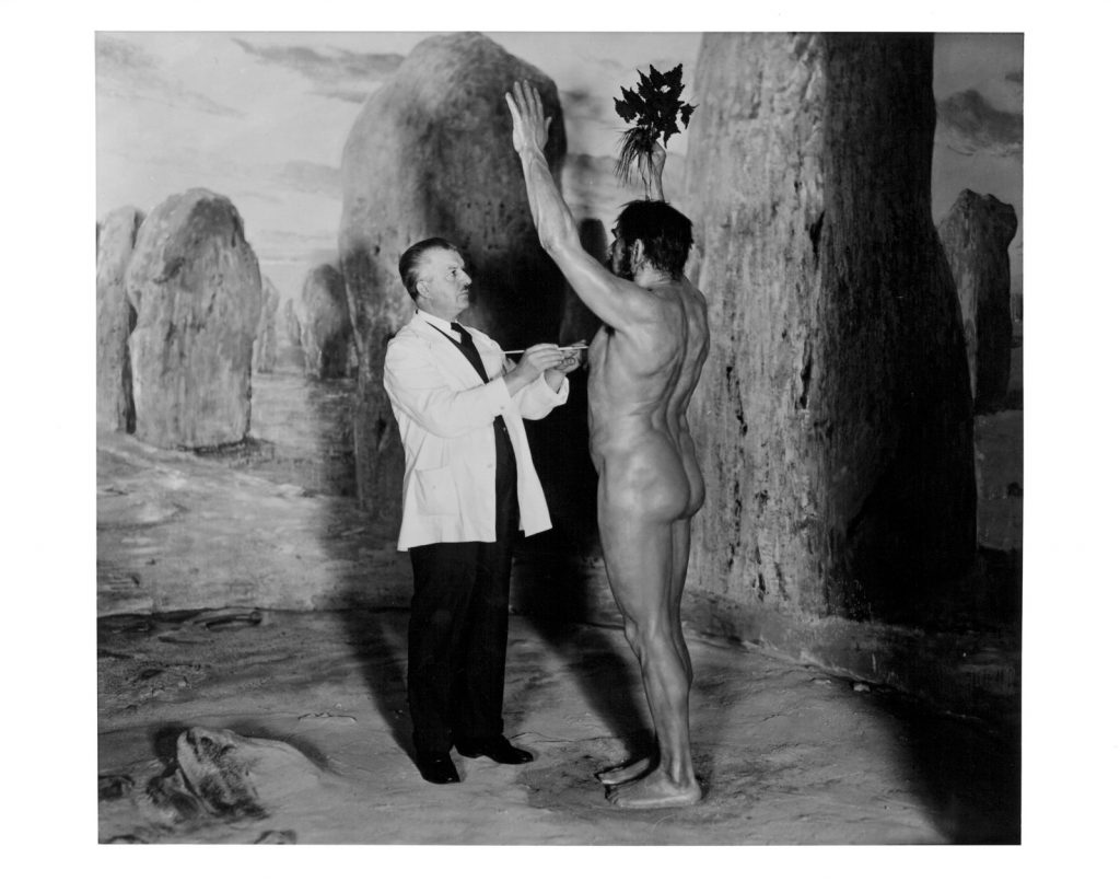 Artist Frederick blaschke putting finishing touches on Neolithic Sun Worship diorama figure at The Field Museum of Natural History, Chicago. 1930. Photograph by museum staff photographer Charles Carpenter. From the exhibition Camera Obscured: Photographic Documentation and the Public Museum. Photograph courtesy The Field Museum of Natural History, Chicago.