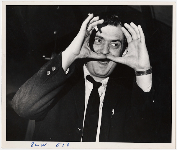 Weegee, [Stanley Kubrick making frame with his hands on the set of his film Dr. Strangelove or: How I Learned to Stop Worrying and Love the Bomb], 1963 © Weegee/International Center of Photography