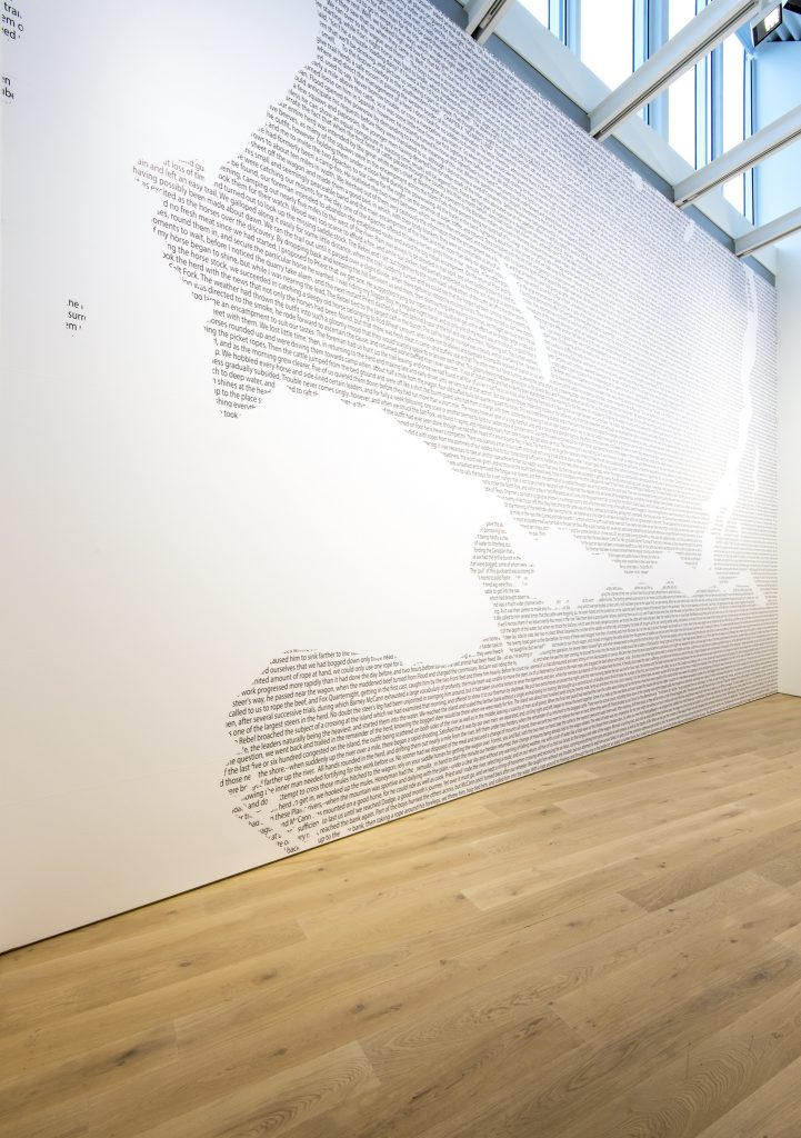 "Installation view, Jordan Abel, ""Cartography (12)"", 2017, text on vinyl, 816 x 538 cm"