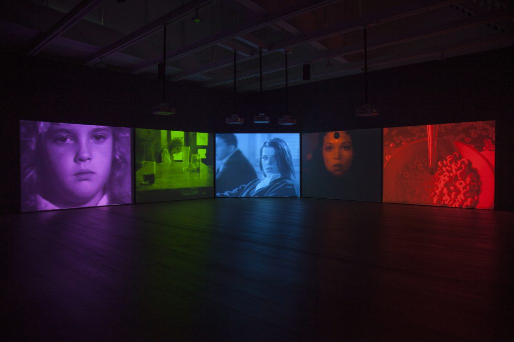 "Installation view, Susan Hiller, ""Psi Girls"", 1999, five-screen video installation with sound, © Susan Hiller; courtesy Lisson Gallery"