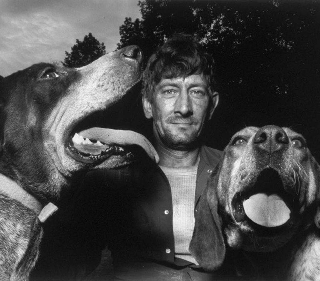 Shelby Lee Adams, Chester with Hounds, 1992. Silver gelatin print. Private Collection